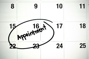 the word appointment is written in black ink and circled on a white montly calendar page
